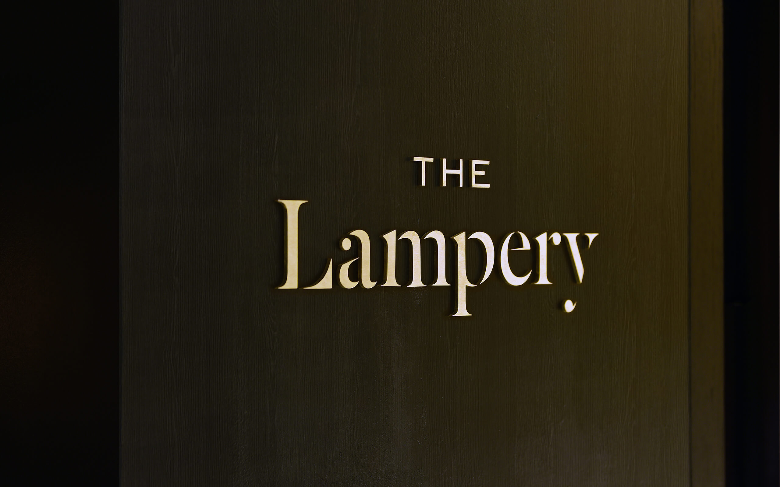 The Lampery logo on wall